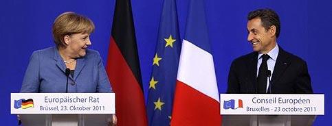 Merkel e Sarzoky ridono dell'affidabilità dell'Italia