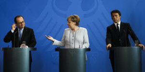 German Chancellor Angela Merkel, center, the Prime Minister of Italy Matteo Renzi, right, and the President of France Francois Hollande brief the media during a meeting at the chancellery in Berlin, Monday, June 27, 2016. The three leaders said they agreed there will be no formal or informal talks, until the British government formally declares its intention to quit the EU. (AP Photo/Markus Schreiber)
